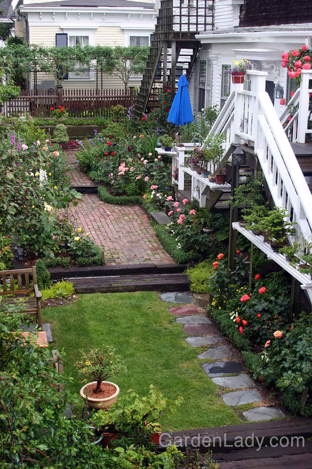 """One way to make a small space more interesting is to divide it into spaces. When a small space is left open, the eye sees it all and the brain says """"This is all there is."""" But when a small yard is divided into garden rooms, the brain says """"There's MORE!"""""""