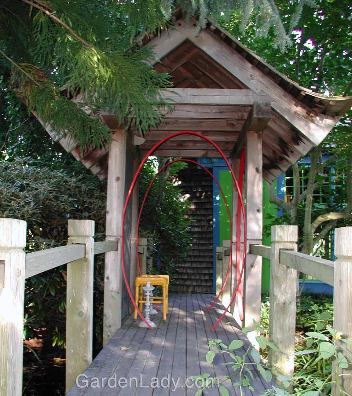 This entry to a garden room, seen on the GWA garden tours in Long Island, reminded me how powerful some simple touches of color can be on garden structures.