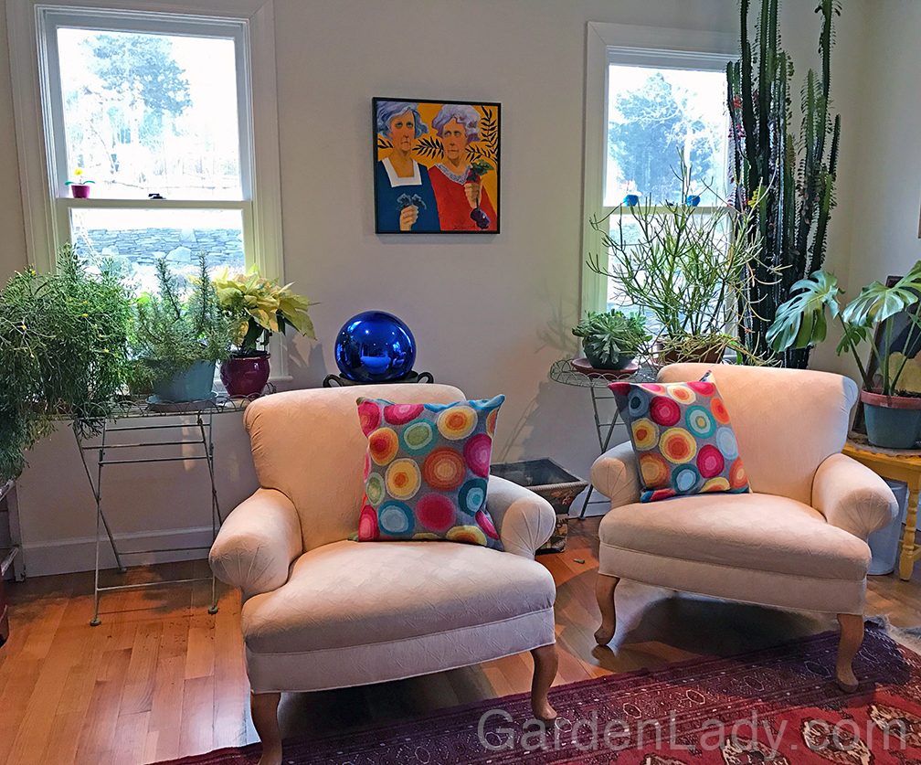 """I took the color palette for this room from the painting by DE Weed. My mother bought this for me, knowing that I'd like the garden theme. She loved the humor in the title, """"I Don't Give A Damn If It's Not Organic."""" But the colorful room is made more pleasant and cheerful by the plants."""